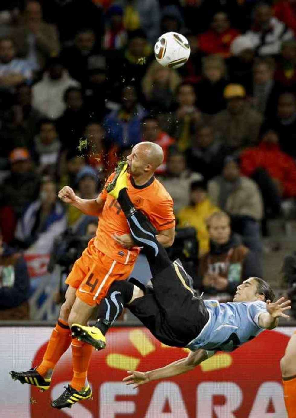 1st Prize Sport Single Netherlands Demy de Zeeuw is kicked in the face by Uruguay's Martin Cáceres during World Cup semi-final, Cape Town, 6 July